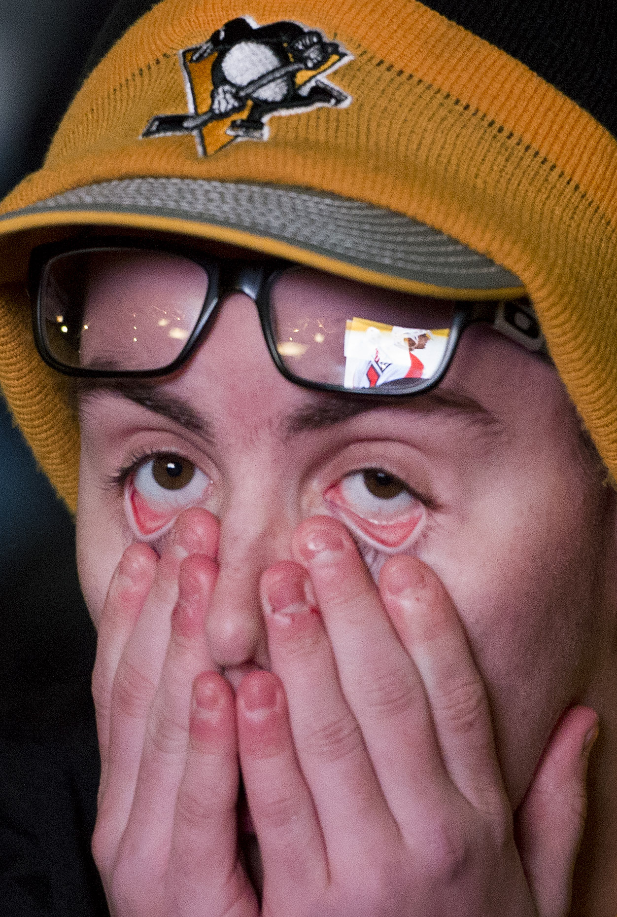 Joey Bova of Bethel Park react as Flyer Valtteri Filppula ties the game while watching the big screen during game 5 of the first-round playoff series against the Philadelphia Flyers on Friday, April 20, 2018, outside PPG Paints Arena. (Steph Chambers/Post-Gazette)