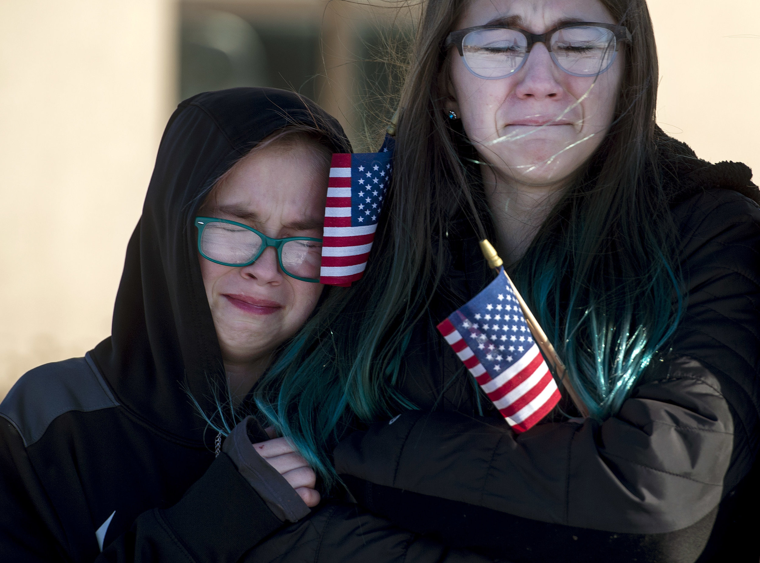 Gabby Karwowski, 10, and her sister Natalie Karwowski, 12, cry as a C-130 carrying their father Master Sgt. Christopher Karwowski returns from deployment on Friday, Jan. 19, 2018, at the 911th Airlift Wing in Coraopolis. Four C-130 aircrafts returned from a four-month deployment to Qatar, the aircrafts' last deployment before retirement. (Steph Chambers/Post-Gazette)