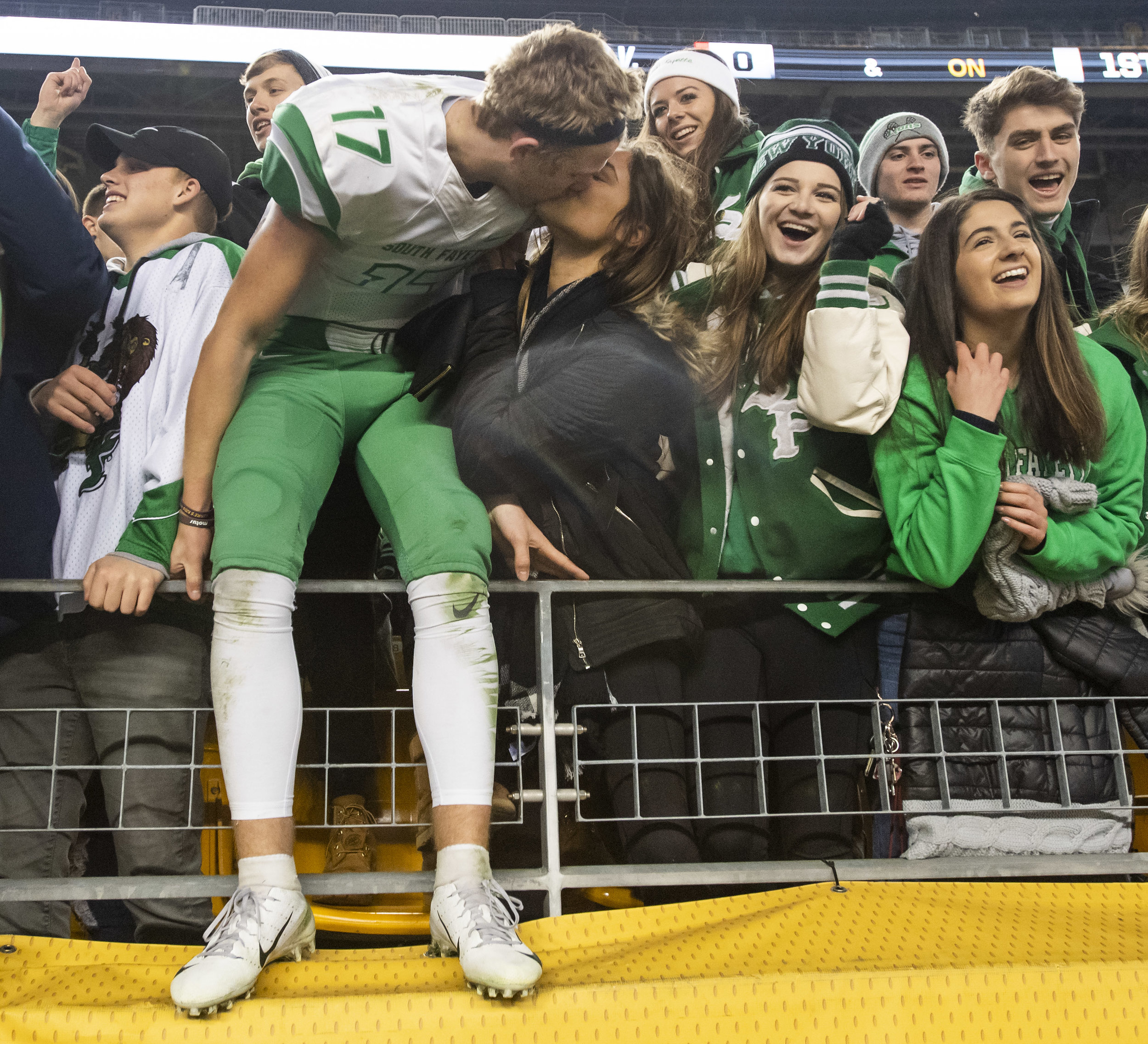 South Fayette's Jamie Diven and Sareena Waskowiak kiss after South Fayette beat Thomas Jefferson, 31-24, during the WPIAL Class 4A championship on Saturday, Nov. 17, 2018, at Heinz Field. (Steph Chambers/Post-Gazette)