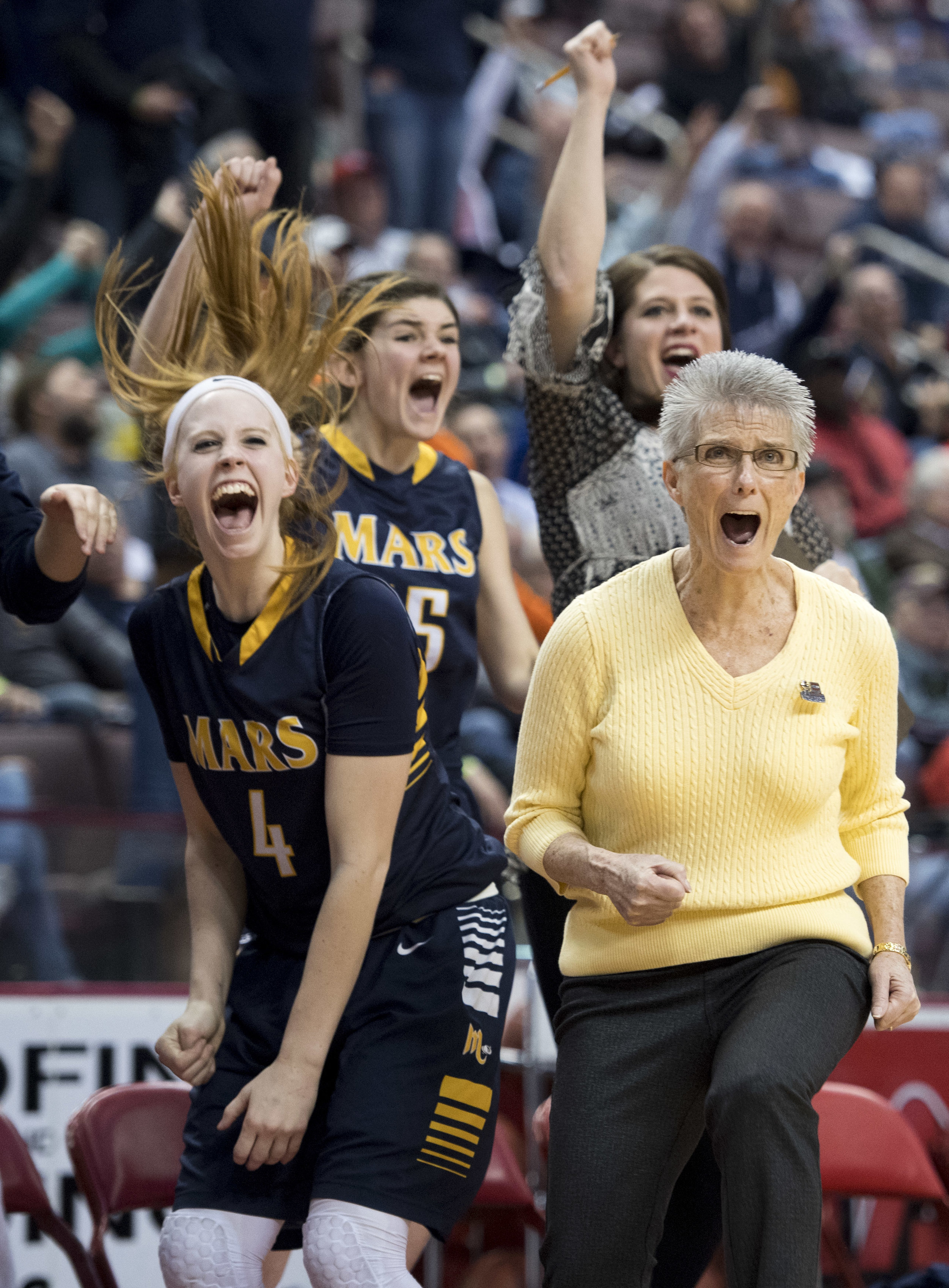 Mars head coach Dana Petruska reacts after Tai Johnson made her shot on a foul during the PIAA class 5A girls basketball championship on Wednesday, March 28, 2018, at the Giant Center in Hershey. Mars beat Archbishop Wood, 36-33. (Steph Chambers/Post-Gazette)