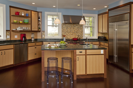 The kitchen cabinetry by KR+H is made of quartered cypress with walnut trim. Counters are honed serpentine.
