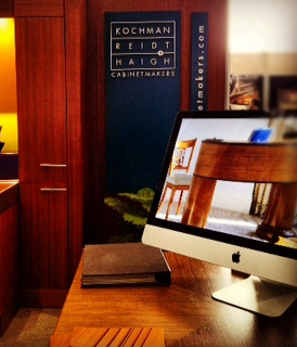 Aliza Reidt captured the desk on KR+H's iMac slideshow at ABX.