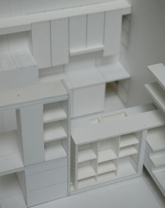 The architect's model. The kitchen design is a series of ' L's.