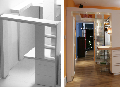 Architect's model and photo showing how the 'L' design works to create a foyer.