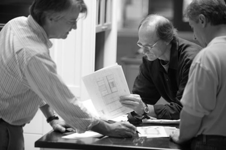 Alan Haigh and Paul Reidt in a meeting with a customer at KR+H's showroom.