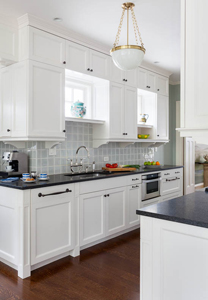 Architect Bill Erickson's design of the kitchen's wall cabinets minimizes the galley effect.