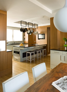 View into the kitchen of the Charles River project. Architecture and Interior Design: Hacin + Associates / Photography: Michael Stavaridis