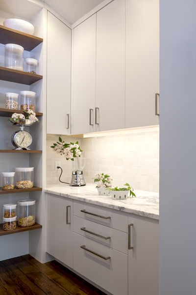 The walk-in pantry is user friendly. It allowed the wall space in the kitchen to be used for lots of windows.