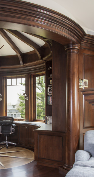 Close-up showing one of the round columns that was shaped exactingly on site by KR+H's master craftsman, Mark Tanis, in order to accurately unite each column with the surrounding millwork.
