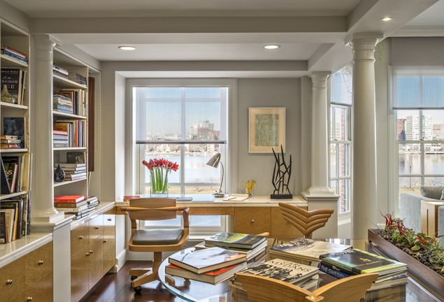 KR+H made these cabinets and bookshelves some 25 years ago. To the right is a large family area with a soaring ceiling. You can glimpse the remarkable view of the Charles River.