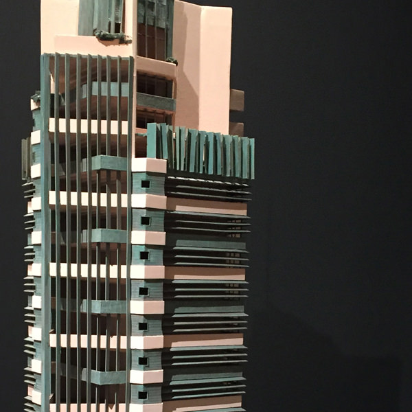 """Close-up of the model for the Price Tower. There's a fascinating (4 minute) video about the restoring of another model, """"Conserving St. Mark's Tower Model,"""" on MoMA's web page for the exhibit. To watch the video,  click here ."""