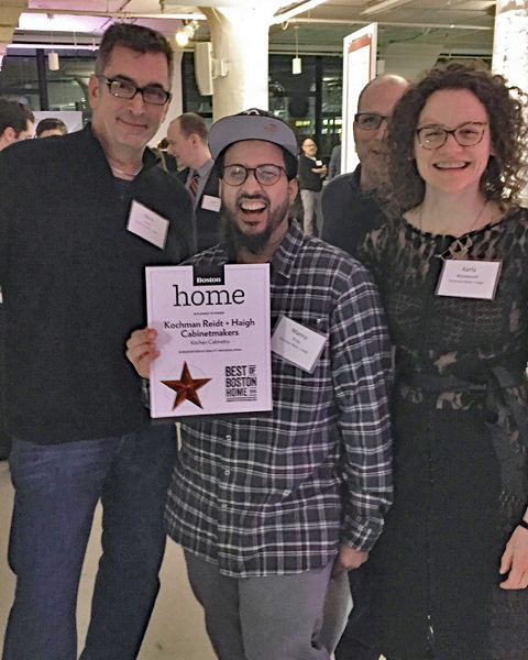 Mark, Manny, Karla, and Jed (peaking over Karla's shoulder) celebrating at the Best of Boston party.