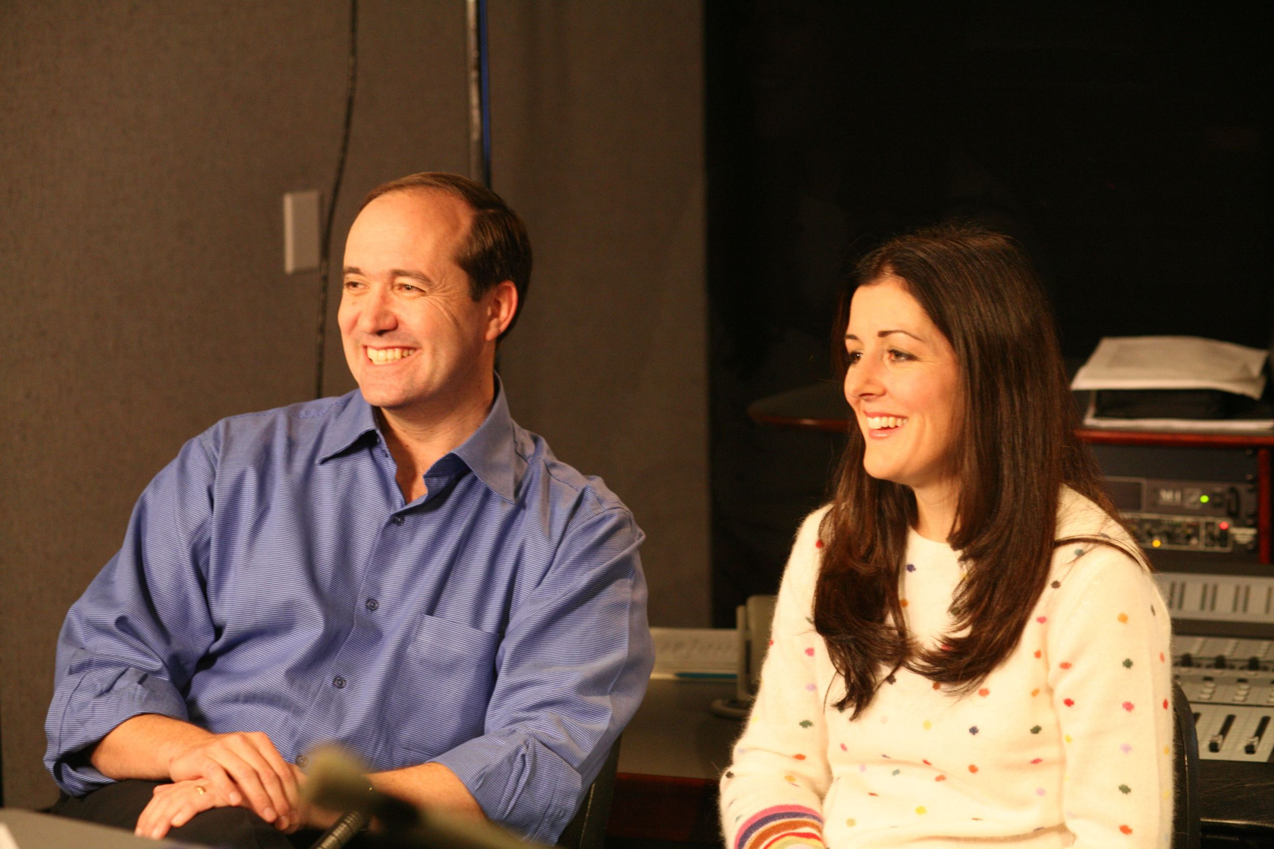 Darrell Van Citters (executive producer) and Ashley Postlewaite (executive producer) smile as they're interviewed behind the scenes