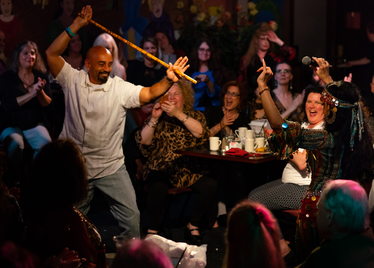 An audience members tries his hand at the cane.