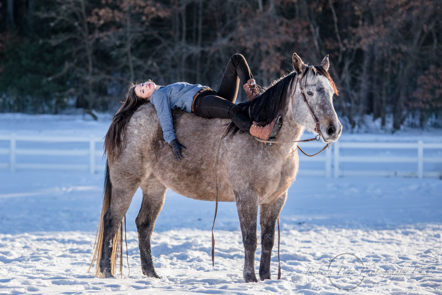 Horse woman laying on her horse. Minnesota horse photographer