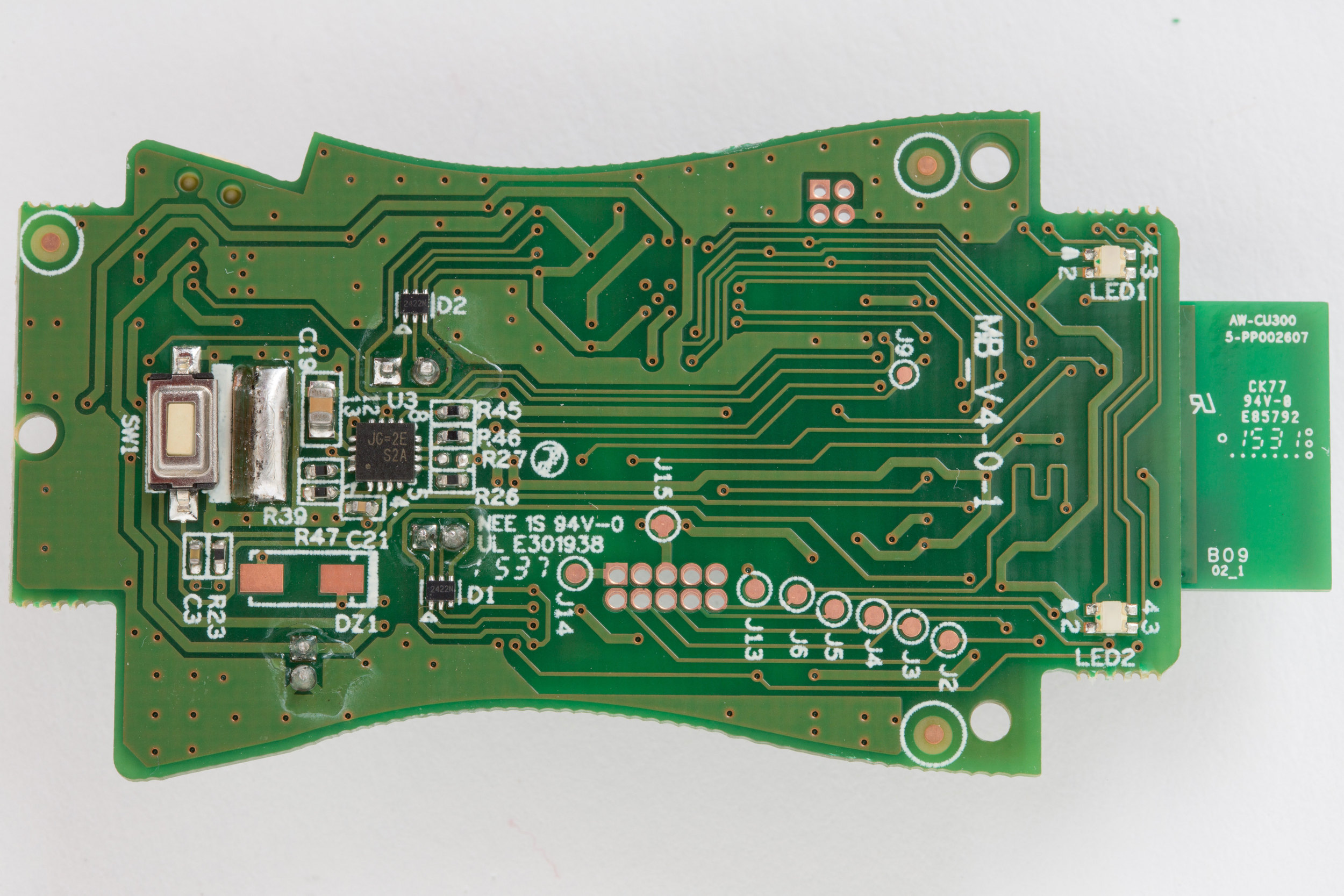 Hello Barbie main circuit board. Back side. Showing LEDs, test points, and main button.