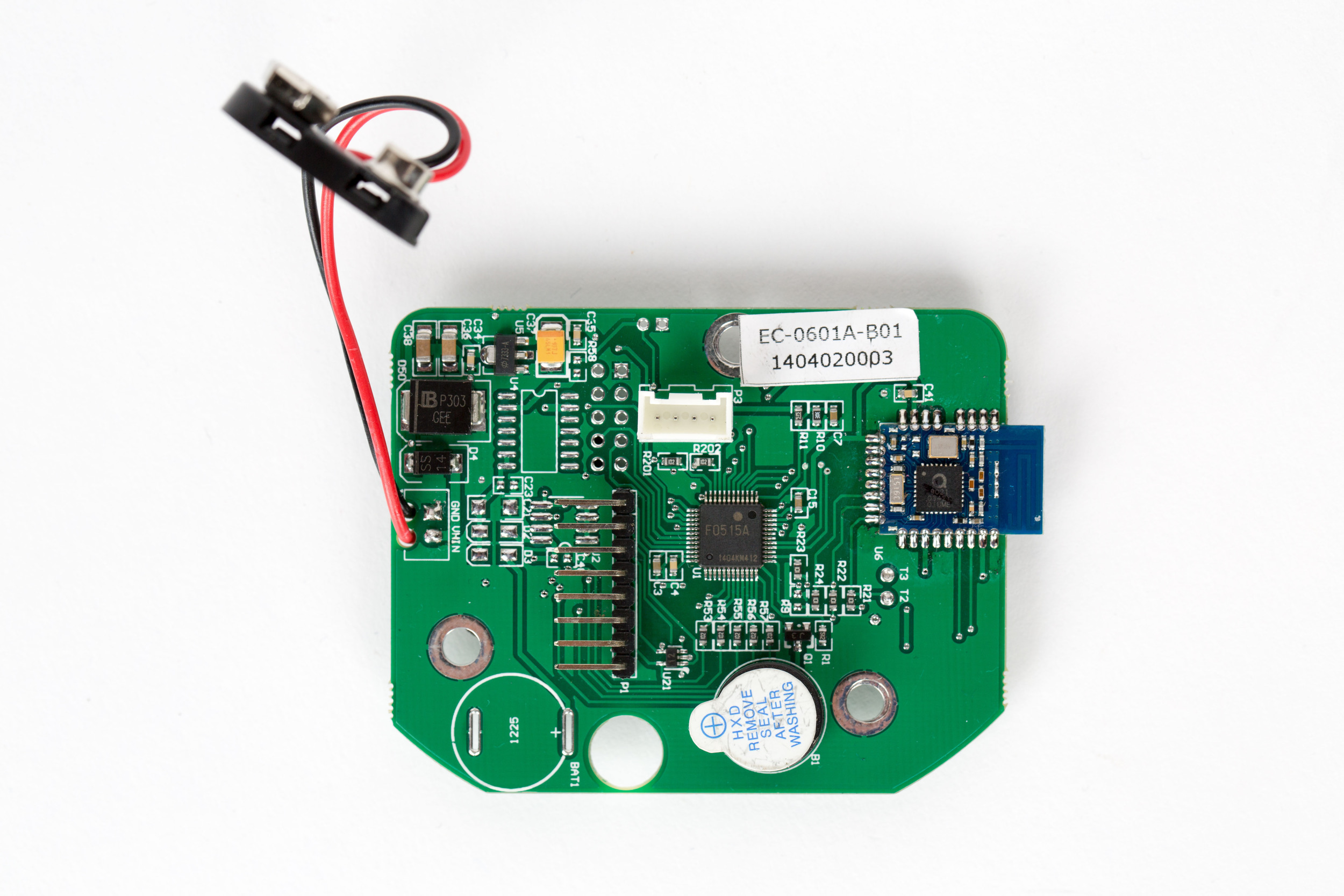 Back side of the entry pad is where the board's main MCU, a    Renesas μPD78F0515A (U1)   , can be found. It's accompanied with an    NXP QN902X SoC (U6)    for BLE communication. Peripherals, such as the 8-pin keypad header (P1) and 4-pin serial interface (P3; ref above) to the lock-body are also located on this side. This serial interface is both used for communication and to carry power to the lock body. There are unpopulated footprints (U2, U4, BAT1), which may have been used in previous revisions of this board, for debugging purposes, or other models of this entry pad.