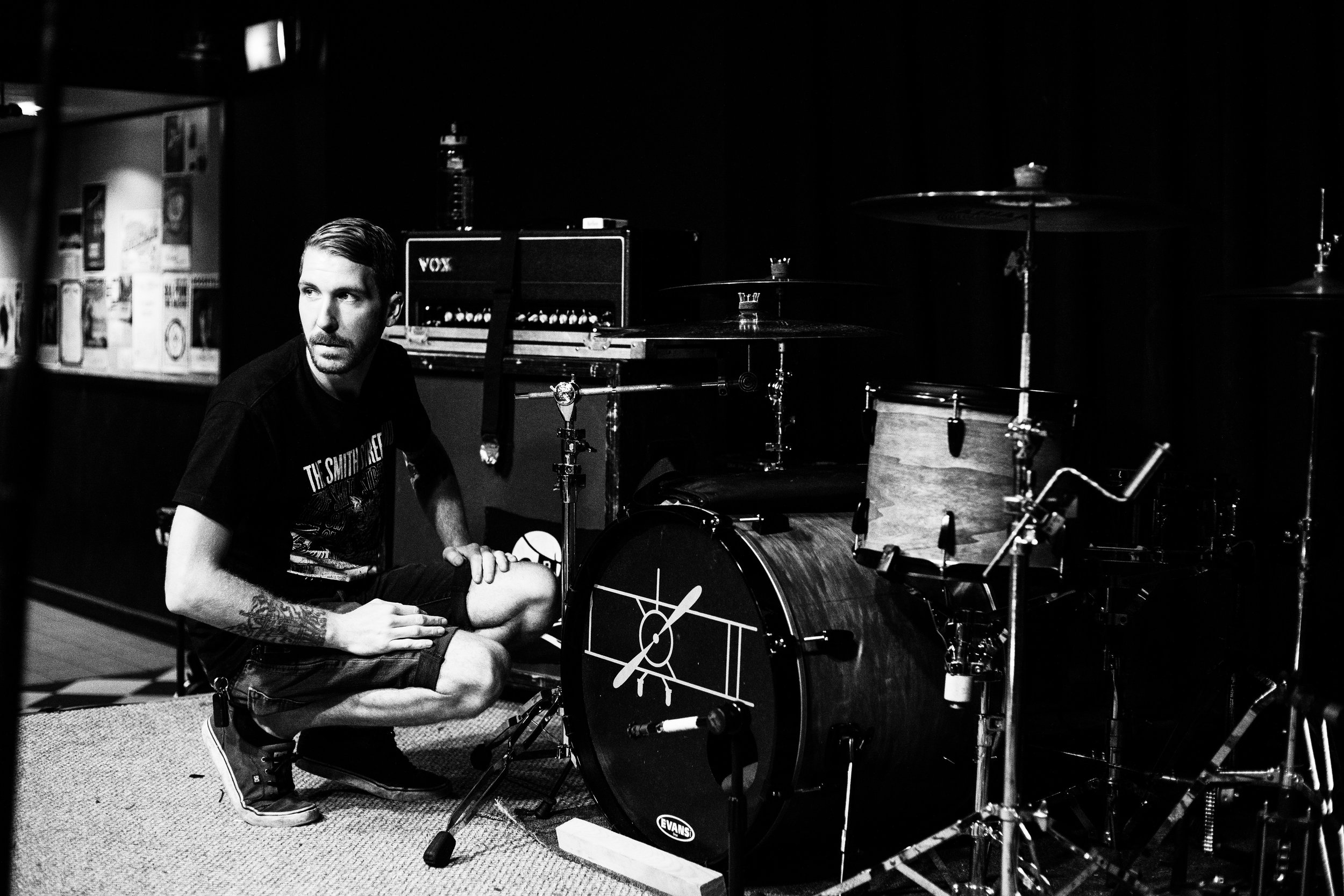 Steve Gibson finishes setting up his drums before soundcheck in Boston, Massachusetts.