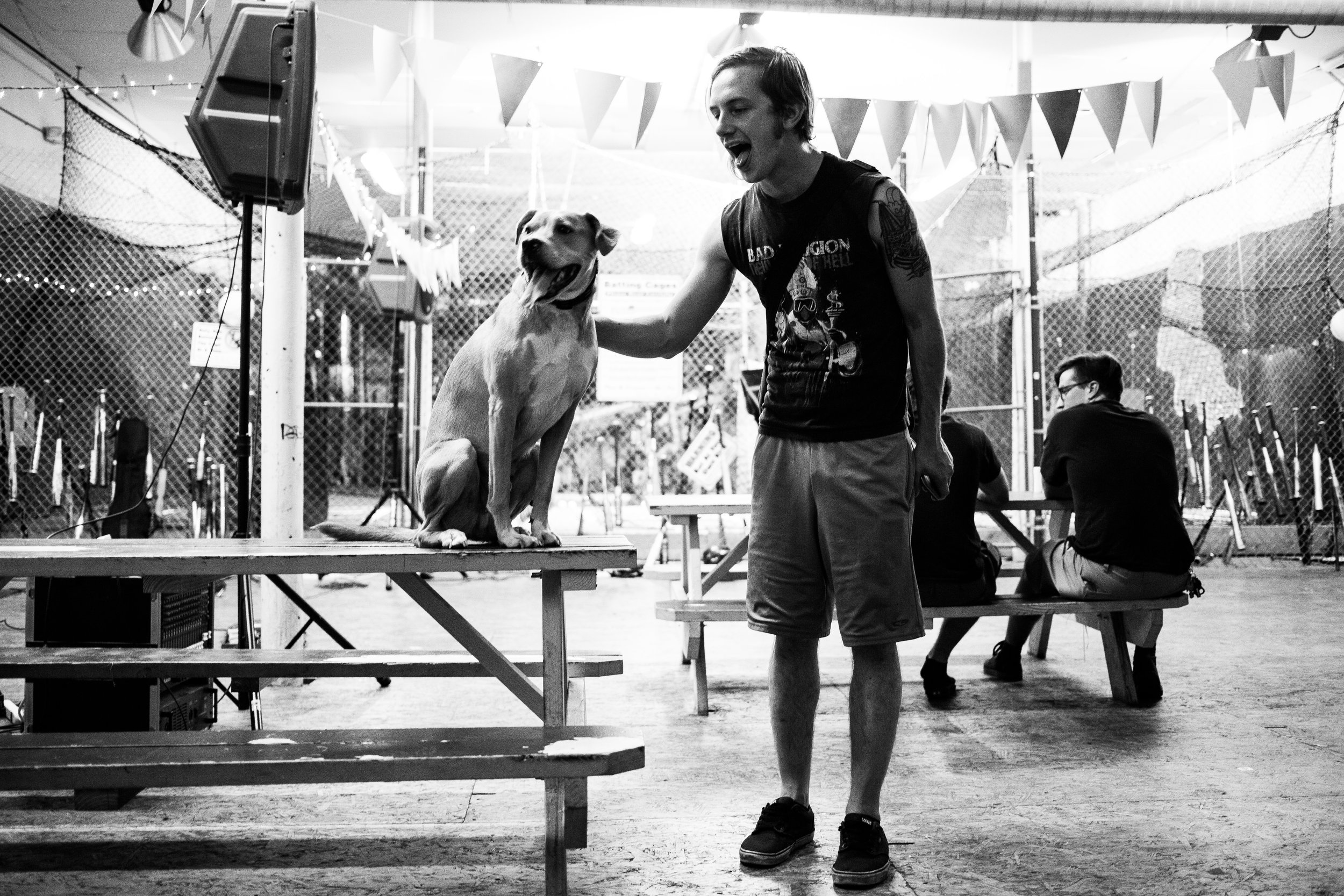 Josh stands with a dog in the venue.