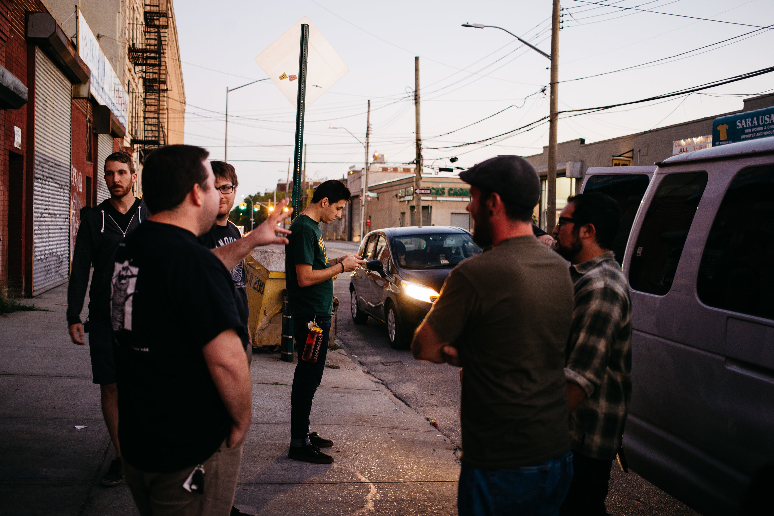 Max on his phone outside of AVIV after the band helped Timeshares with their load in that evening in Brooklyn, New York.