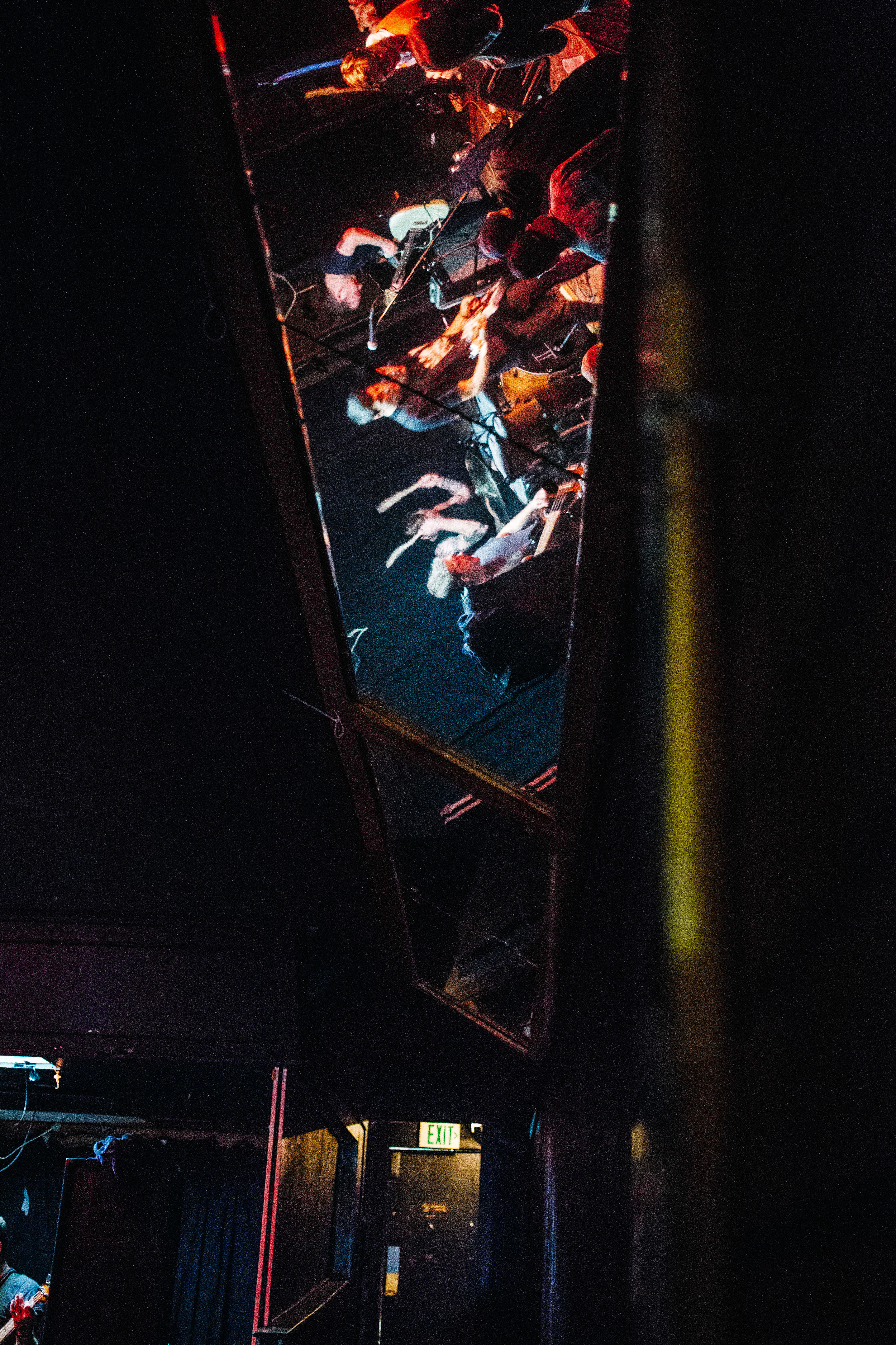 The venue had mirrors all along the walls. Here the band is reflected in a ceiling mirror.