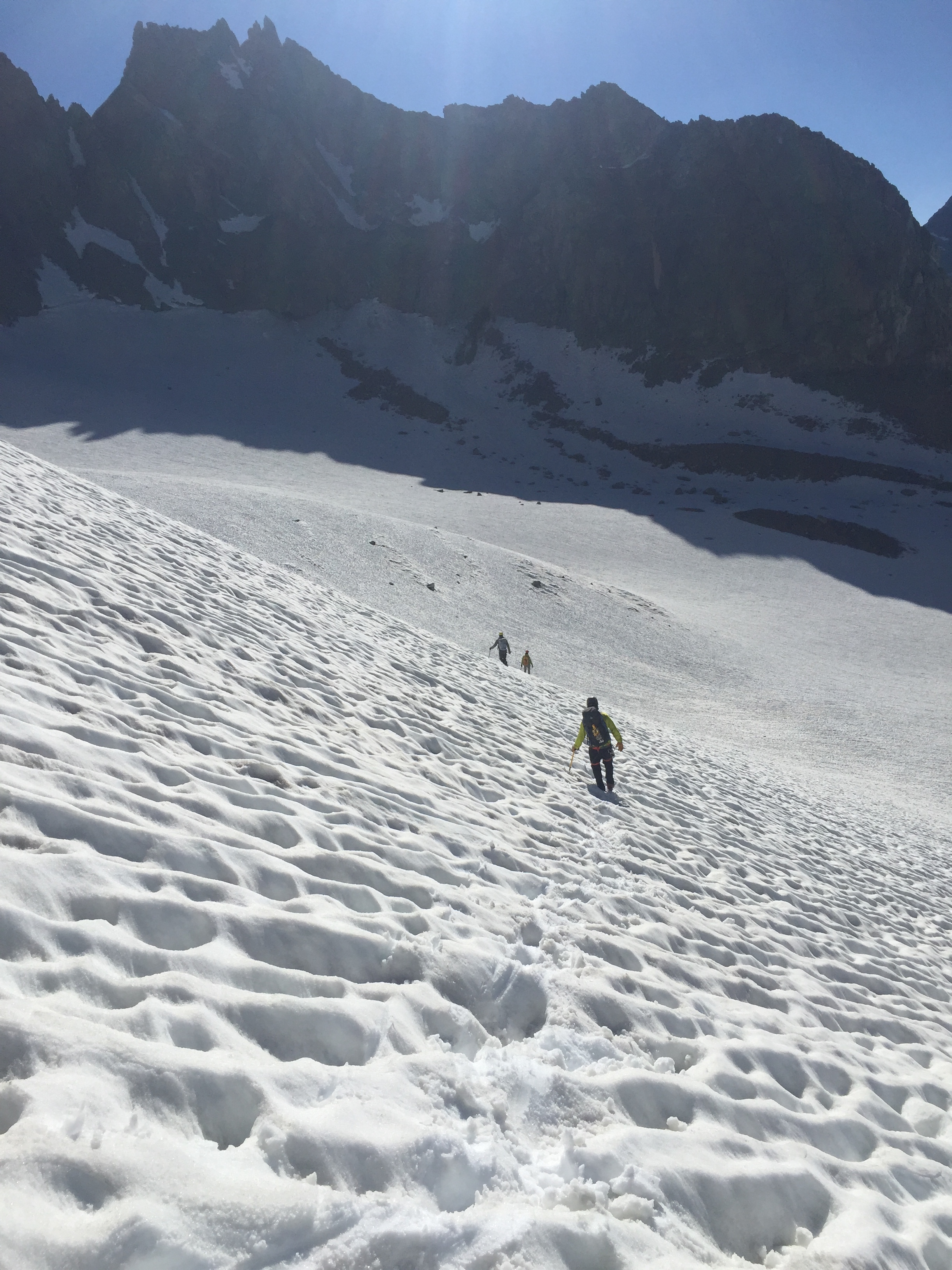Descending the south icefield, with some of the peaks that form the Palisade Traverse in the background