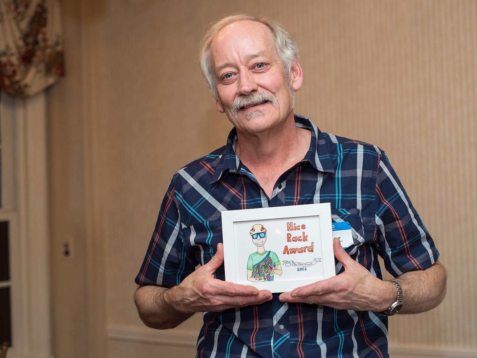"Steve NIchols showing off his ""Nice Rack"" award"