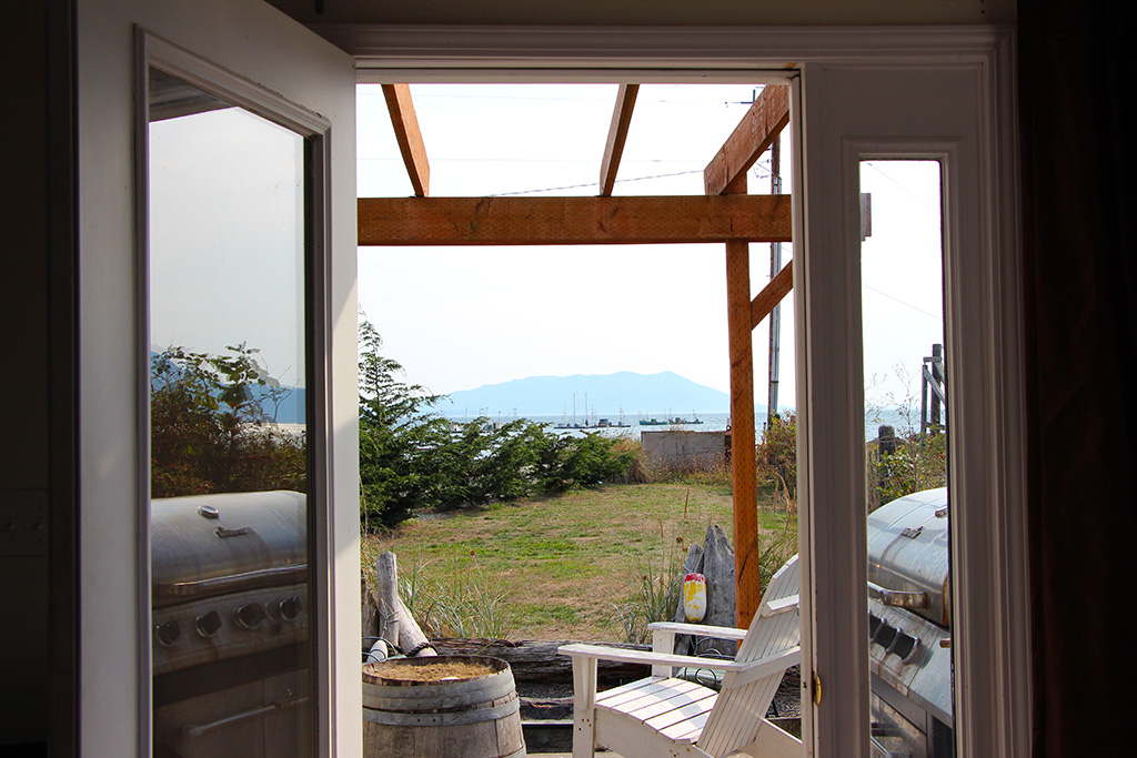 Deck bar with view of Rosario Strait and Orcas Island.