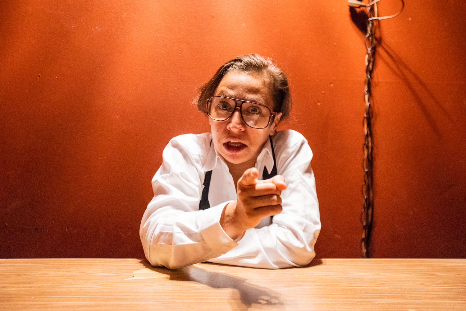 Jackie Rivera as Larry King in  Tiny Errors at the End of the Millennium  at IRT Theater. Photo by Al Foote III.