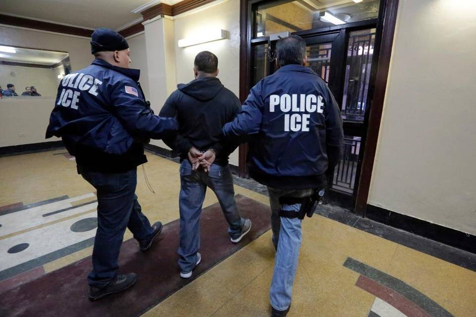 The nation's highest immigration court has blocked the deportations of a handful of families who were apprehended as part of an effort to combat illegal immigration. In this March 3, 2015 photo, Immigration and Customs Enforcement officers escort a detainee in an apartment building in the Bronx borough of New York during a series of early-morning raids. Richard Drew AP