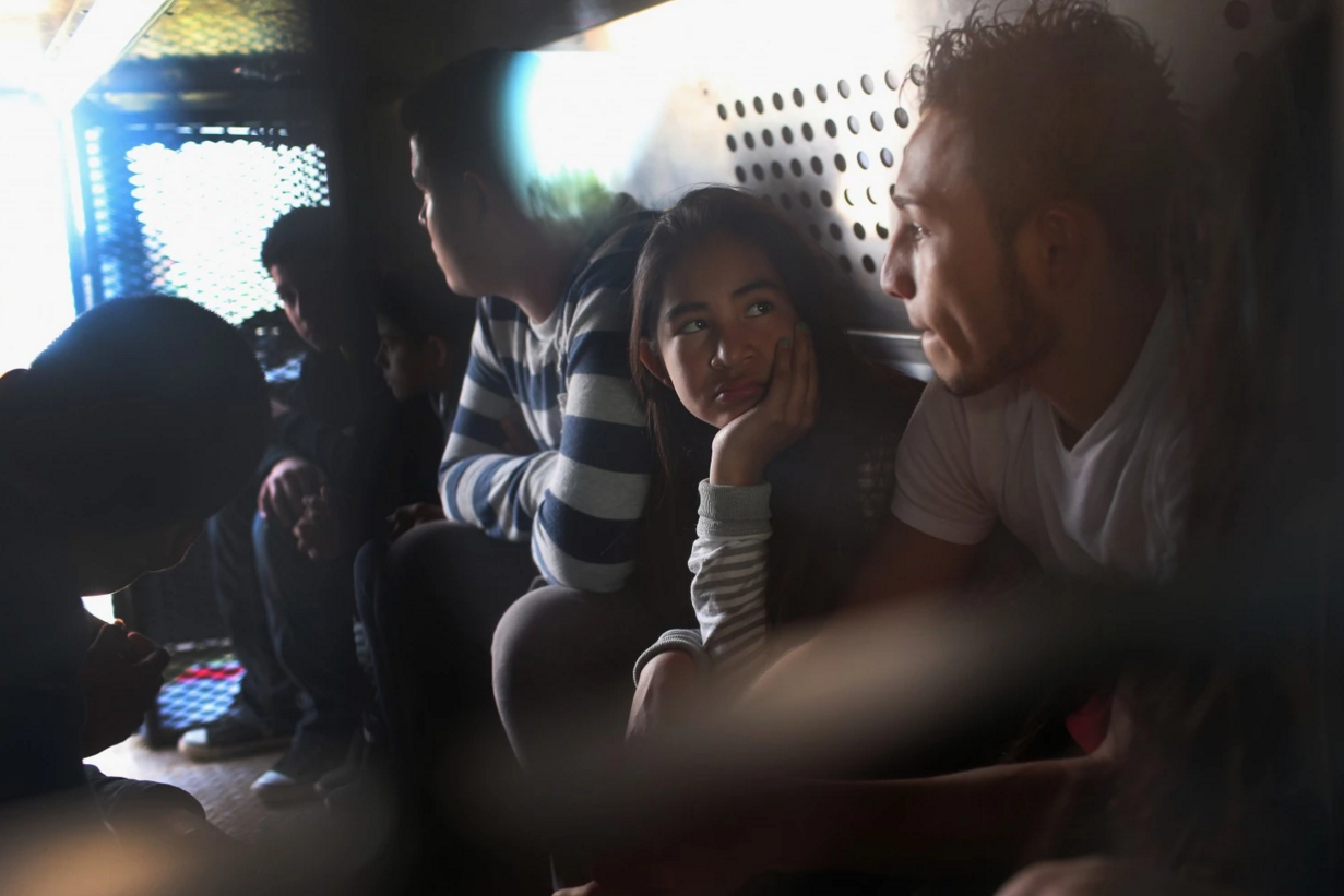 Central American immigrants wait to be transported after turning themselves in to U.S. Border Patrol agents on Dec. 8, 2015, after crossing the U.S.-Mexico border into Texas to seek asylum. (John Moore/Getty Images)