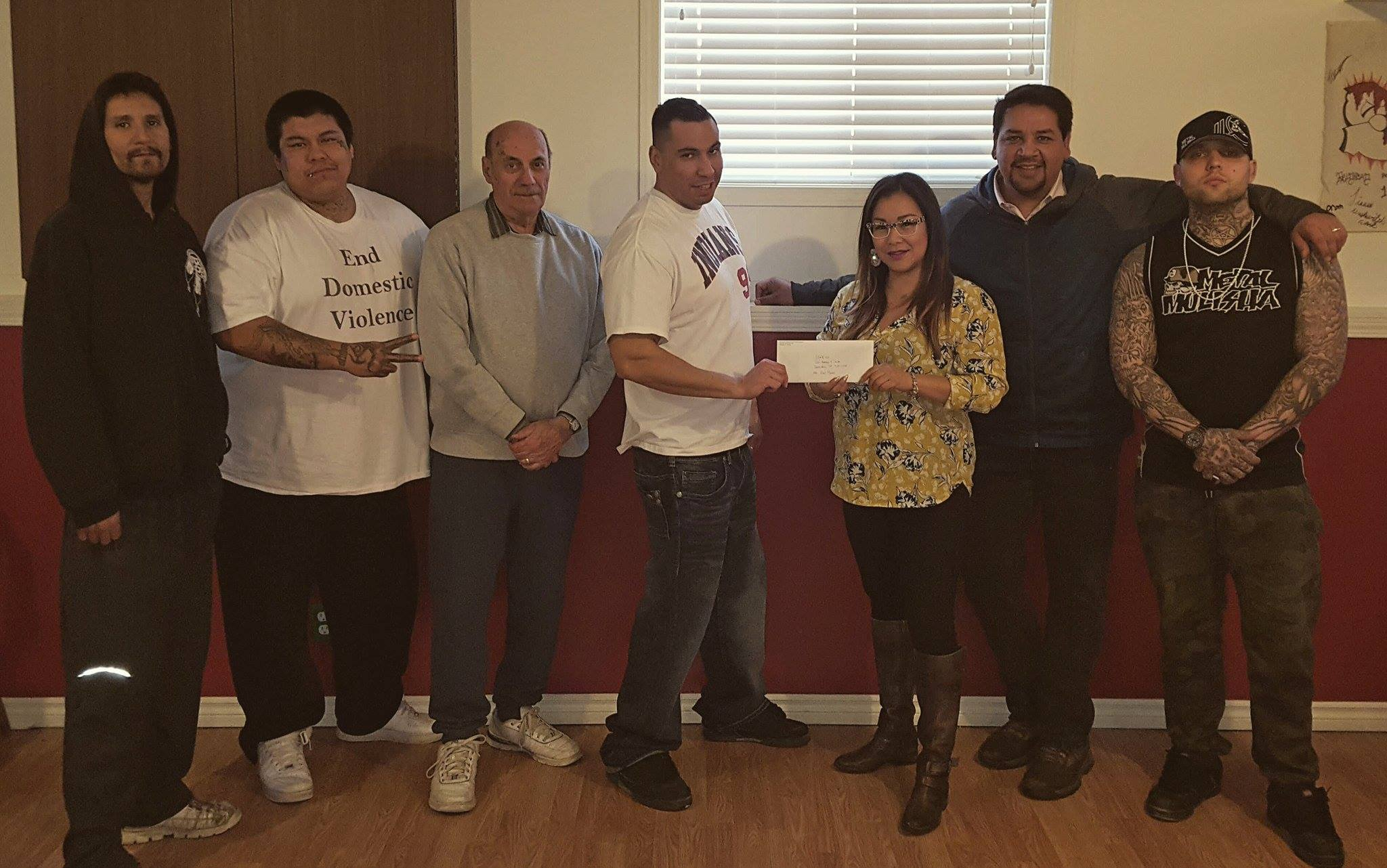 ASWFF's contribution of $25,000 was received by Str8-Up members Dale Isaac, Chris Moyah, Father Andre, Dave Stephenson, Tara Worme, Alex Munoz and Brad Christianson. Picture taken by Shane Taysup.