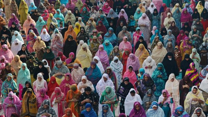 Arif Ali/AFP/Getty Images: Muslim women at Eid al-Adha prayers at the Badshahi Mosque in Pakistan.