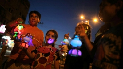 """Palestinian children holding the traditional """"Fanous"""" lanterns:  Retrieved from  Times of Israe"""