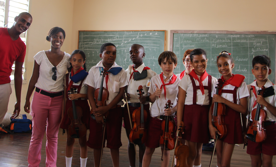 THE OPEN STRING WITH 2ND AND 3RD GRADE STUDENTS AND TEACHERS AT THE ESCUELA ELEMENTAL DE ARTE PAULINA CONCEPCIÓN IN HAVANA, CUBA. THIS MUSIC-FOCUSED PUBLIC SCHOOL TRAINS STUDENTS AGES 7 THROUGH 14 FOR MUSICAL CAREERS. THE OPEN STRING DONATED OVER 300 STRINGS FOR VIOLINS, VIOLAS, AND CELLOS TO ADDRESS THE LACK OF FUNDS AND ACCESS TO STRINGS AND SUPPLIES IN THE NATION.