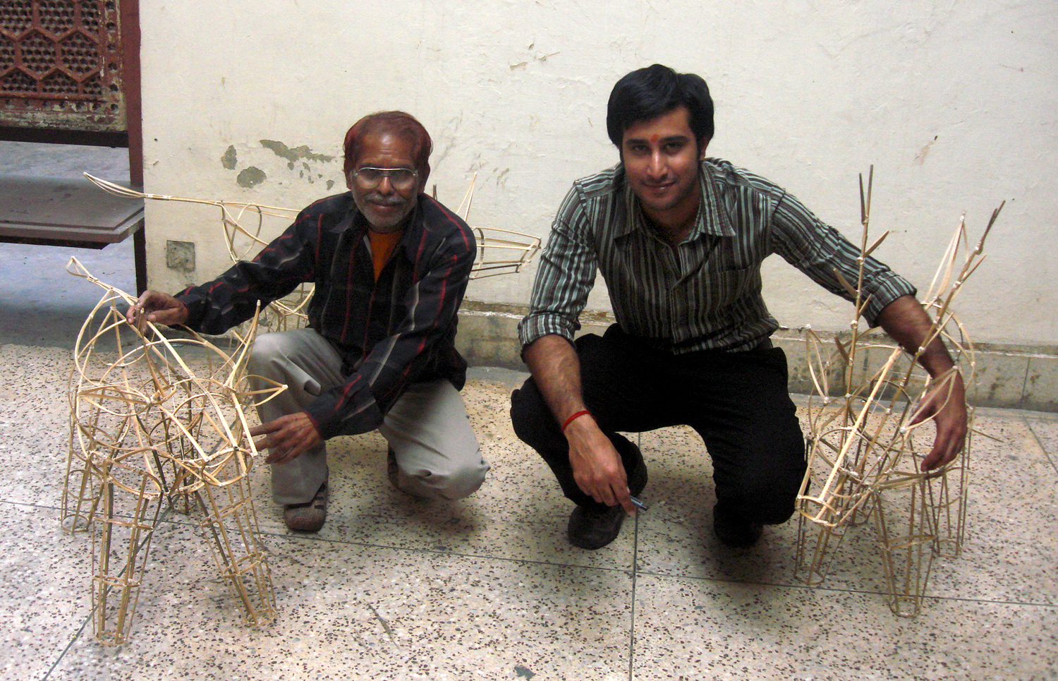 Abhimanyu with the master craftsman who helped build the lamps out of bamboo, cloth and handmade paper.