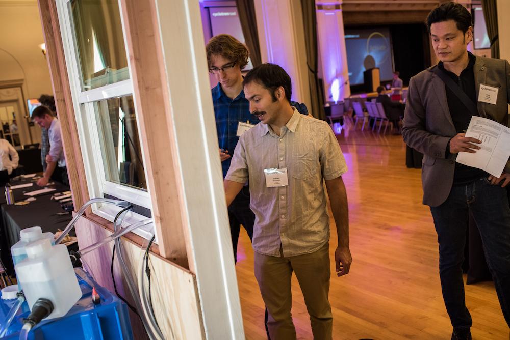 Treau cofounder Adrien Benusiglio and ARE Fellow Adam Rutkowski adjusting their demo as Intermolecular CTO Tony Chiang looks on.