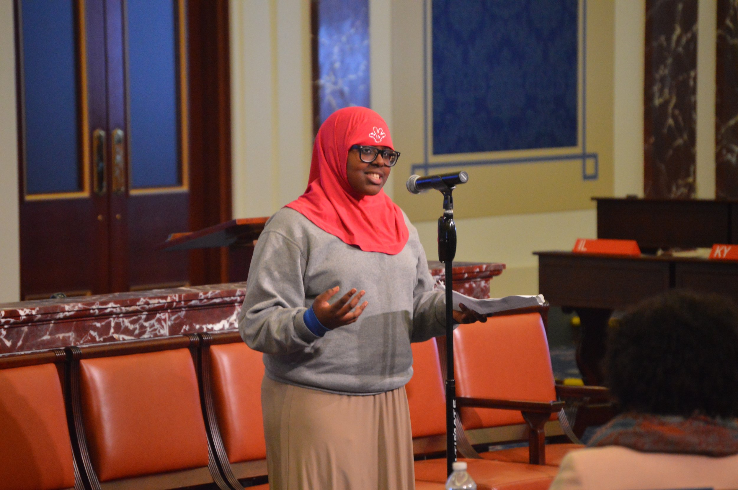 "Ny'lasia Brown (L) and Sumeya Aden deliver their poems at ""Speak Up! Art is Action"" in October."
