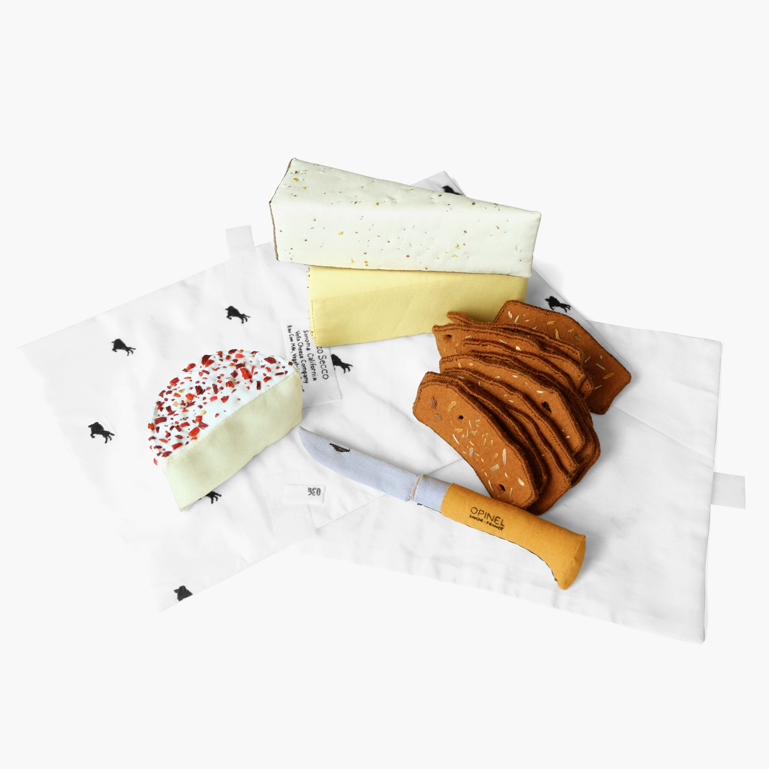 Triple Cream Dream    Cheeses, crostini, and Opinel knife from Cowgirl Creamery   Foam, fiberfill, felt, cotton cloth, embroidery floss Approximately 4.5 x 15 x 11 in 2015