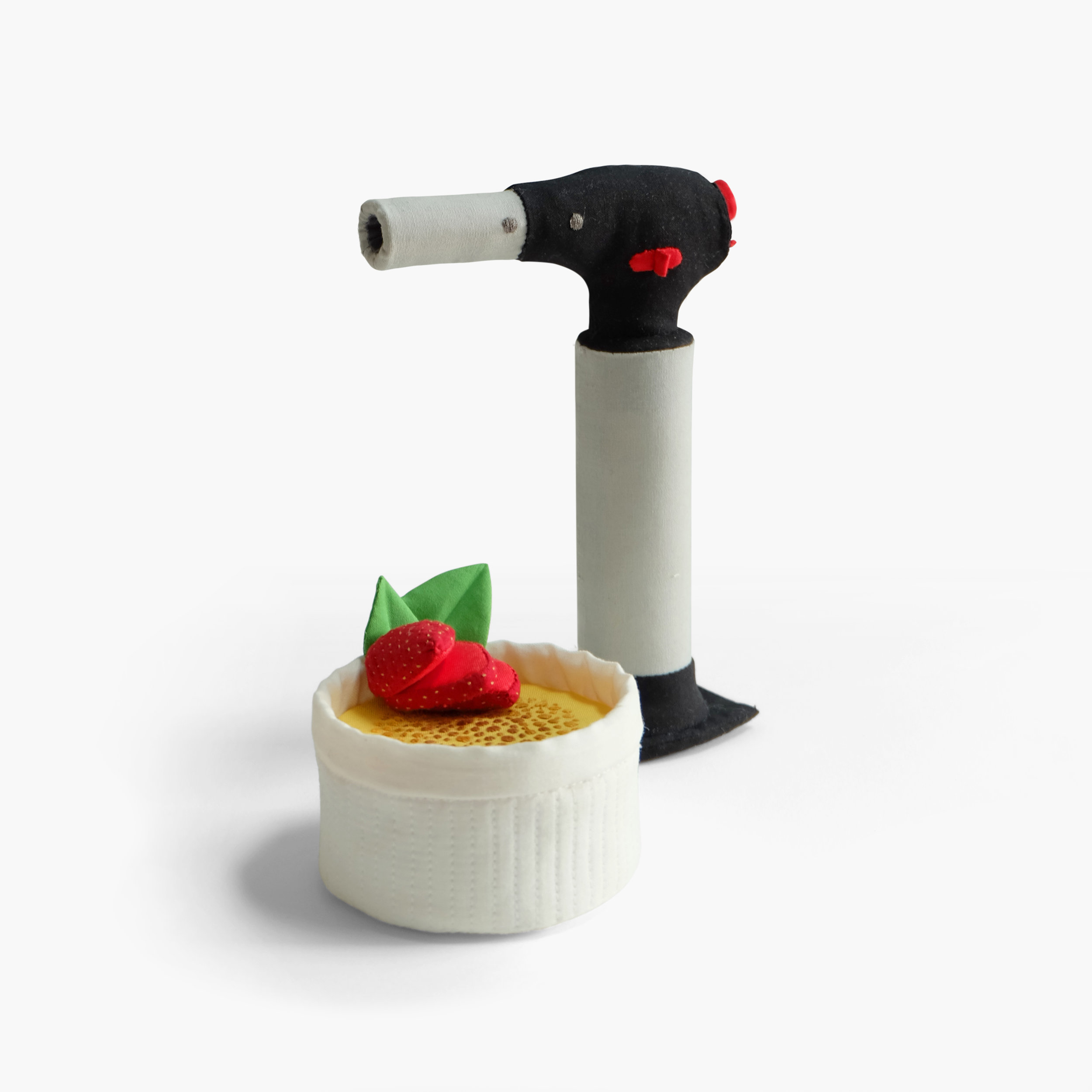 Sous Vide for One    Crème brûlée and kitchen torch   Fiberfill, felt, cotton cloth, embroidery floss Approximately 7.5 x 5.25 x 6 in 2014