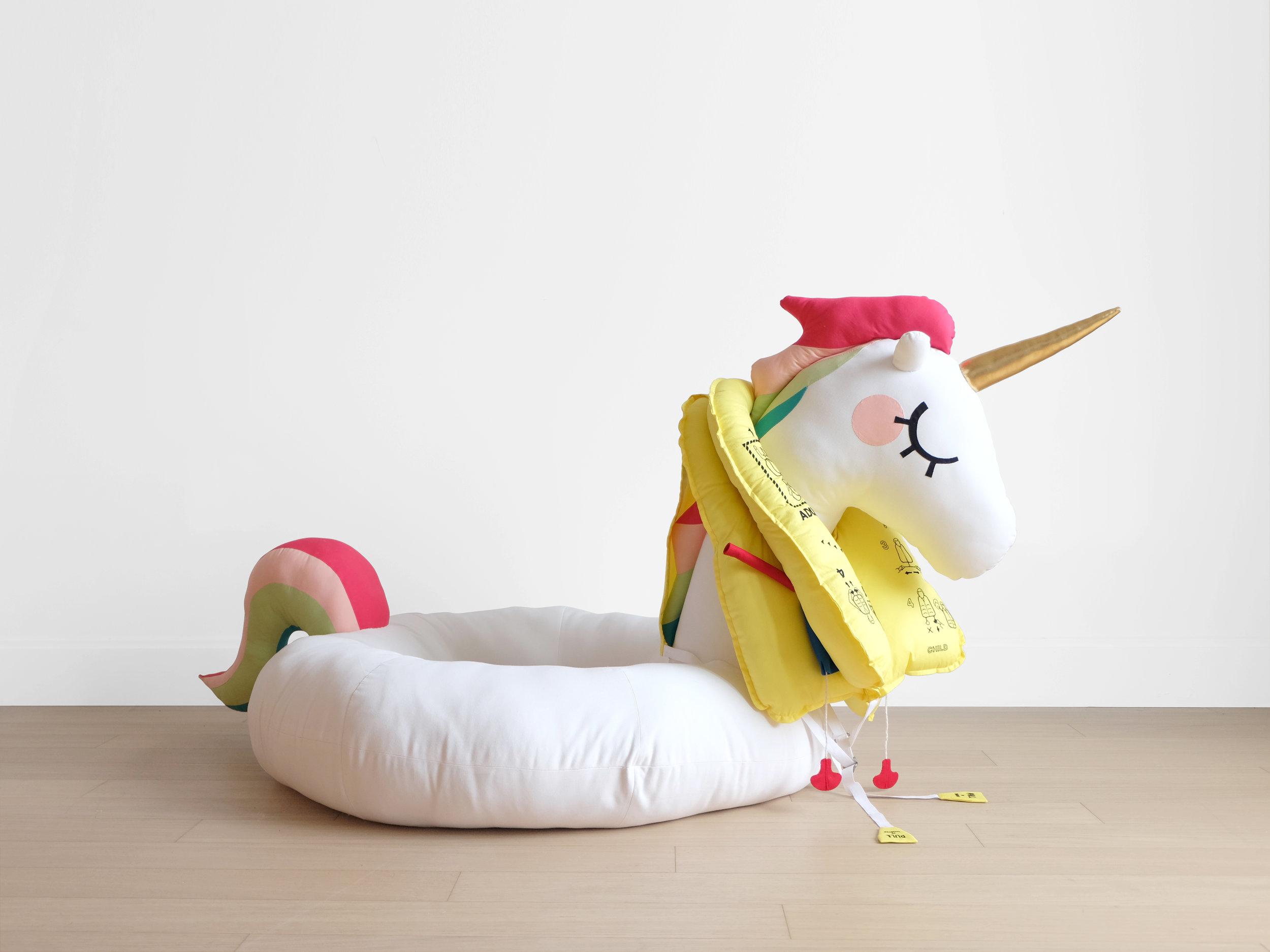 Mimi O Chun  Save the Unicorns!  Foam, batting, fiberfill, wood, felt, cotton cloth, elastane, embroidery floss, webbing, rope, metal belt parts Approximately 60 x 42 x 43 in 2018