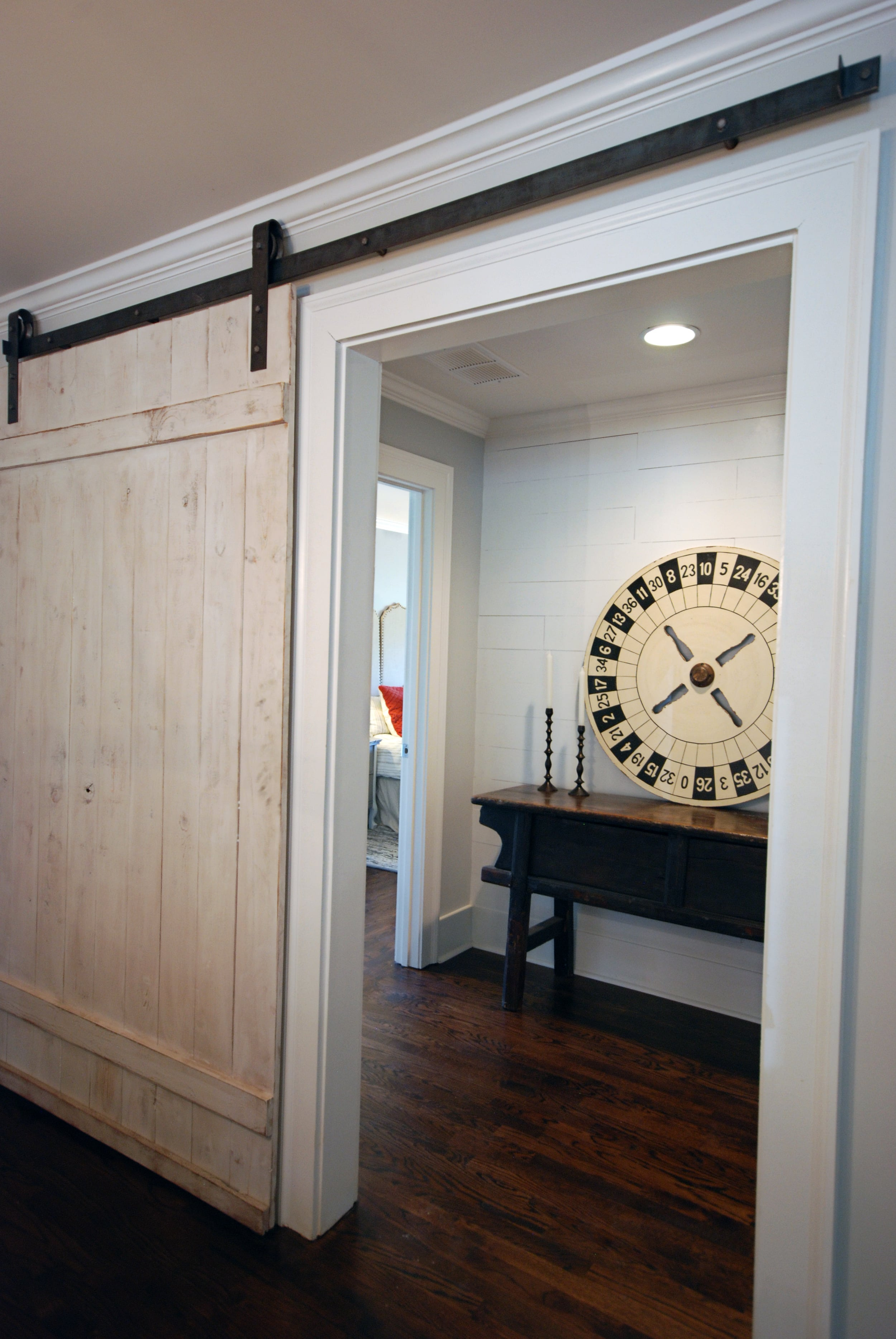 Custom touches such as barn doors and plank walls make this house feel like a home.