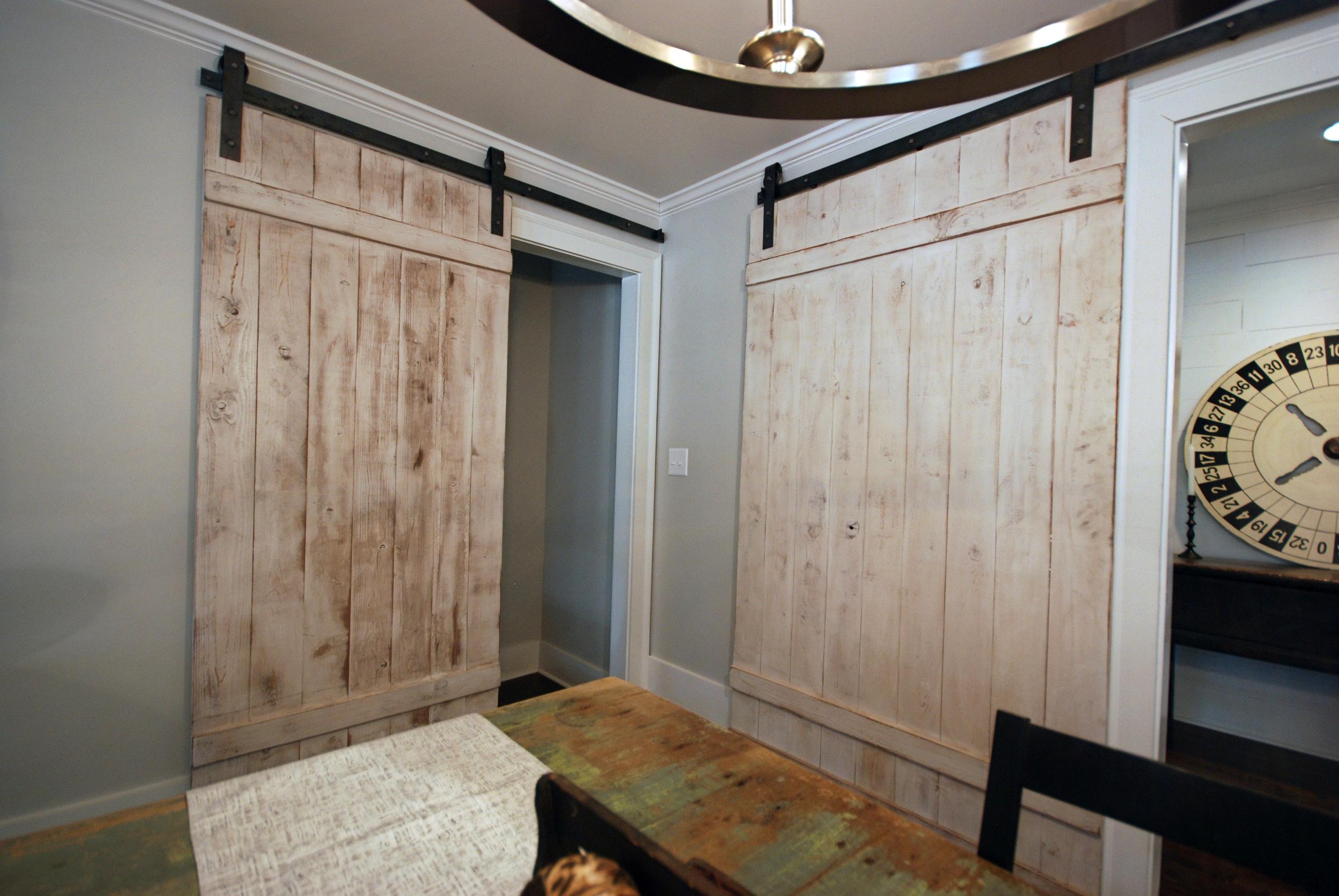Barn doors via Drum Homes
