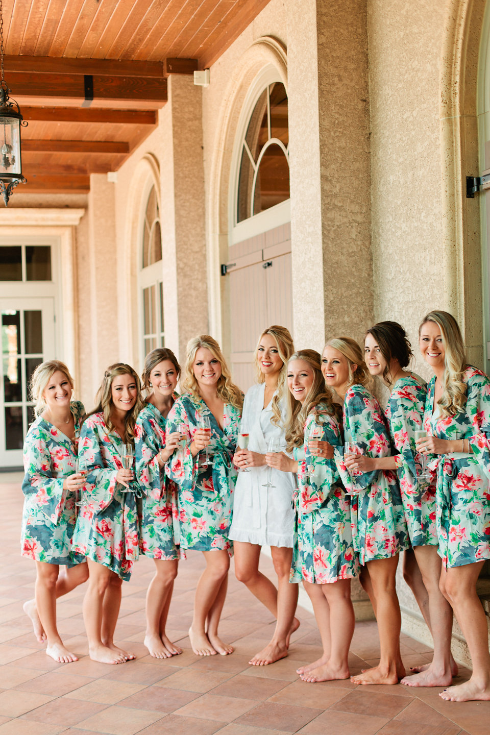 Floral Bridal Party Robes  Blush Wedding at TPC Sawgrass Wedding Ponte Vedra Beach  Jacksonville Wedding Planner Blue Ribbon Weddings  Jacksonville Wedding Photographer Debra Eby Photography  Wedding Ceremony & Reception at TPC Sawgrass Jacksonville