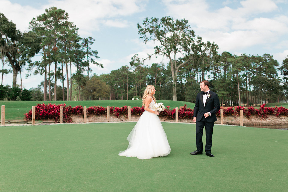 TPC Sawgrass first look on 17th hole  Blush Wedding at TPC Sawgrass Wedding Ponte Vedra Beach  Jacksonville Wedding Planner Blue Ribbon Weddings  Jacksonville Wedding Photographer Debra Eby Photography  Wedding Ceremony & Reception at TPC Sawgrass Jacksonville