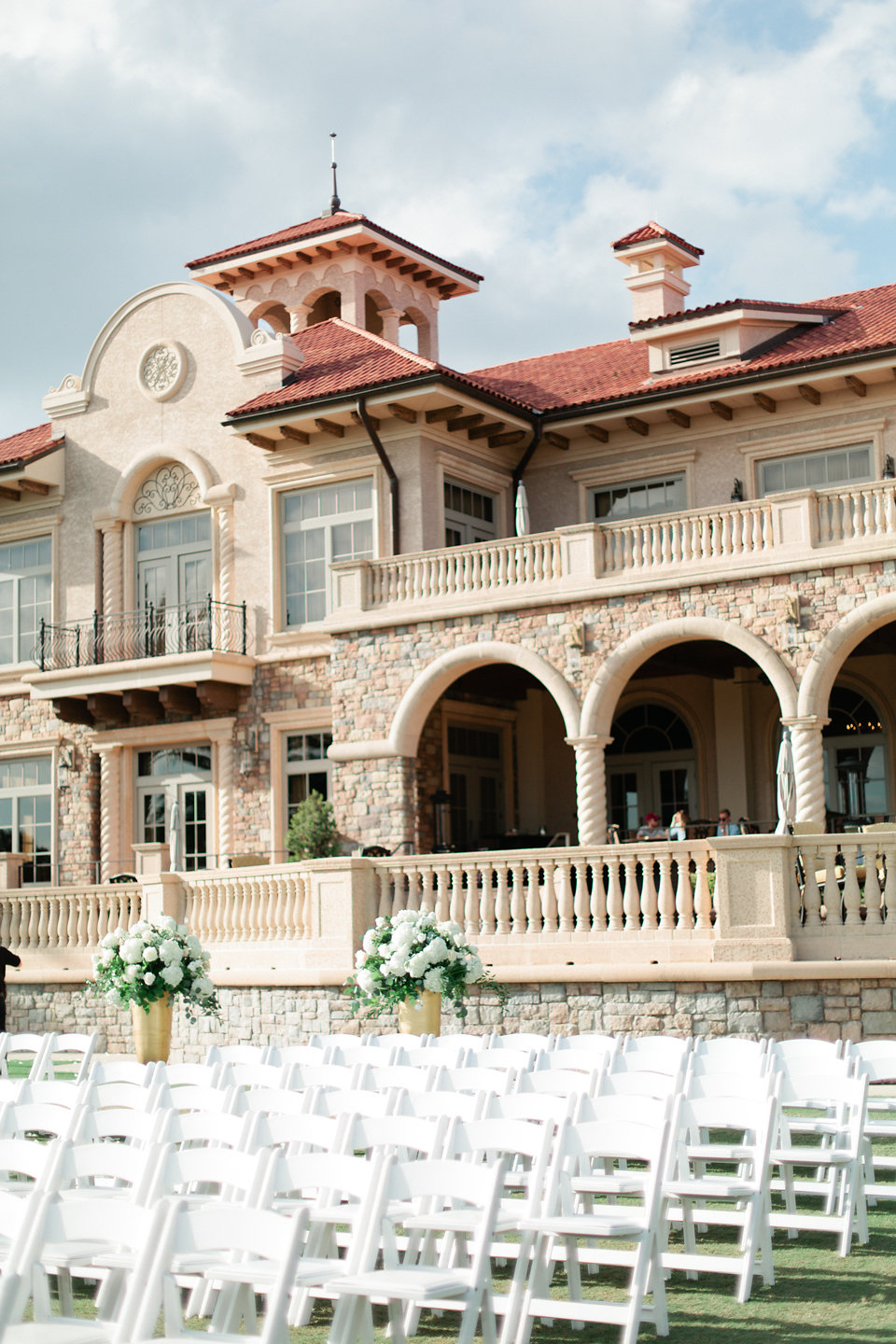 TPC Sawgrass ceremony overlooking the clubhouse and golf course  Blush Wedding at TPC Sawgrass Wedding Ponte Vedra Beach  Jacksonville Wedding Planner Blue Ribbon Weddings  Jacksonville Wedding Photographer Debra Eby Photography  Wedding Ceremony & Reception at TPC Sawgrass Jacksonville
