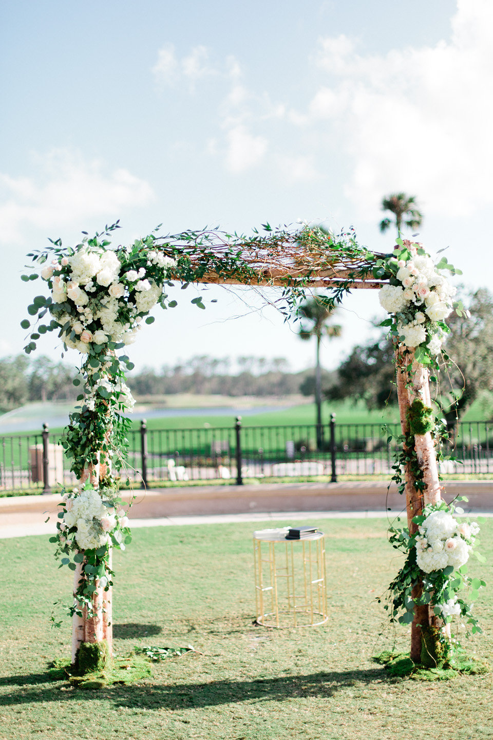 Blush and ivory blooms with greenery on wedding arch TPC Sawgrass Jacksonville  Blush Wedding at TPC Sawgrass Wedding Ponte Vedra Beach  Jacksonville Wedding Planner Blue Ribbon Weddings  Jacksonville Wedding Photographer Debra Eby Photography  Wedding Ceremony & Reception at TPC Sawgrass Jacksonville