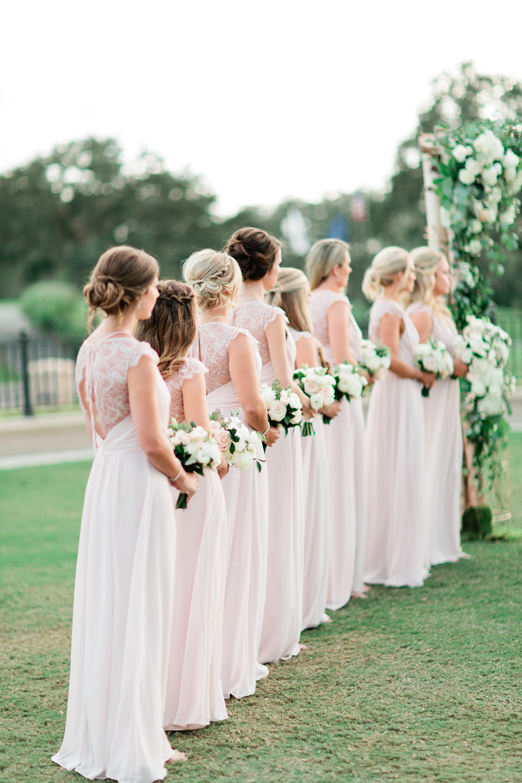 Blush bridesmaid at wedding ceremony