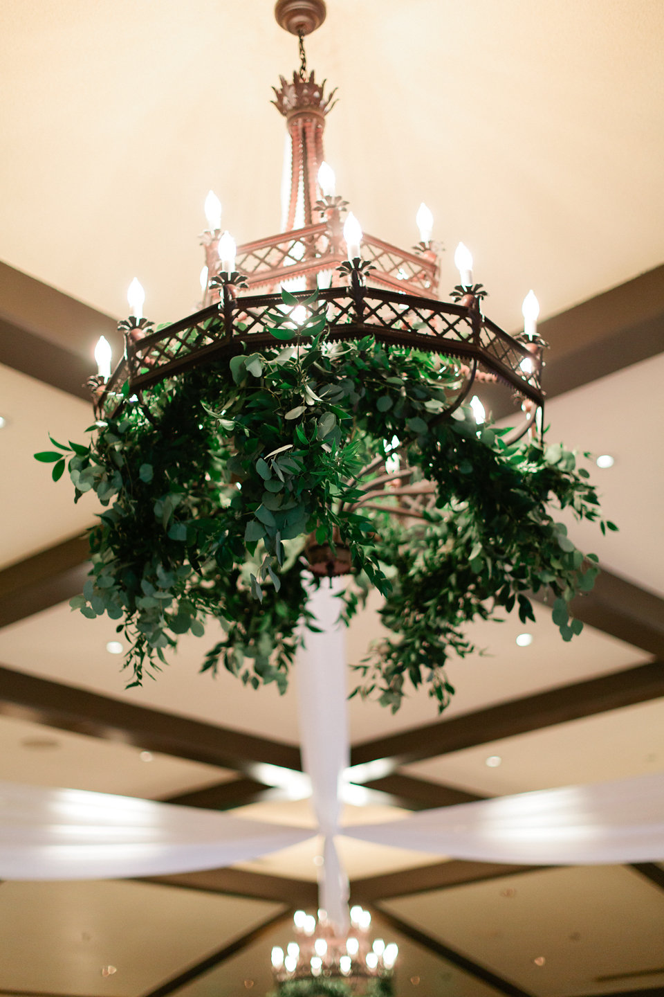 Chandelier with greenery and draping at TPC Sawgrass Clubhouse  Blush Wedding at TPC Sawgrass Wedding Ponte Vedra Beach  Jacksonville Wedding Planner Blue Ribbon Weddings  Jacksonville Wedding Photographer Debra Eby Photography  Wedding Ceremony & Reception at TPC Sawgrass Jacksonville