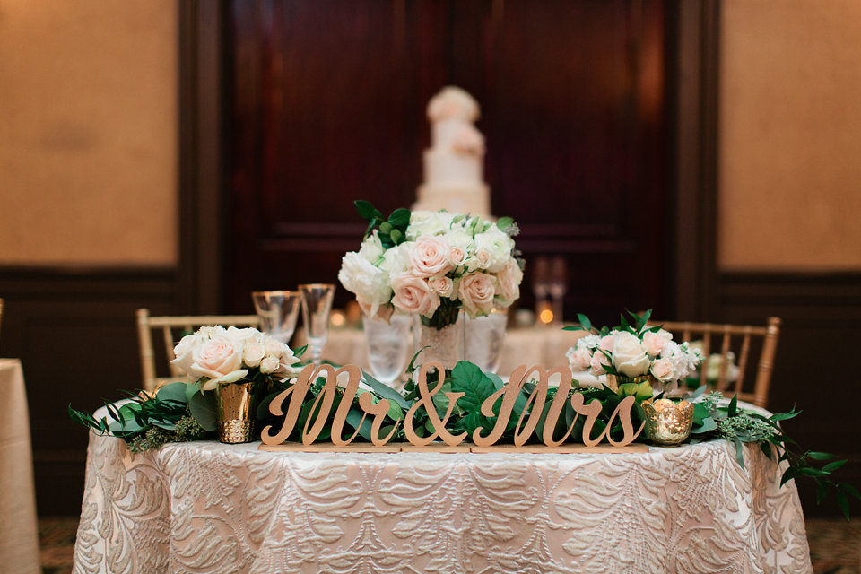 Blush, Ivory & Gold Sweetheart Table with Garland and Gold Signage  Blush Wedding at TPC Sawgrass Wedding Ponte Vedra Beach  Jacksonville Wedding Planner Blue Ribbon Weddings  Jacksonville Wedding Photographer Debra Eby Photography  Wedding Ceremony & Reception at TPC Sawgrass Jacksonville